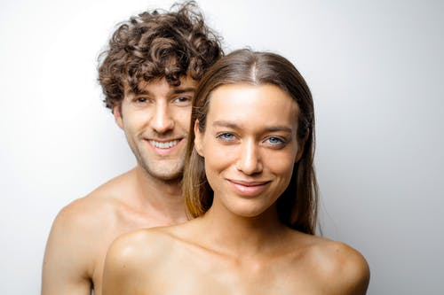 Topless Woman Beside Smiling Man