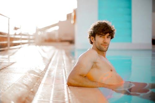 Topless Man in Swimming Pool