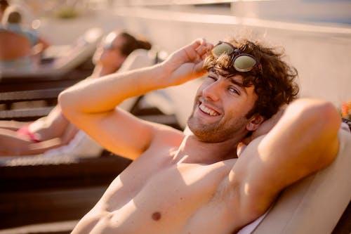 Topless Man Wearing Black Sunglasses