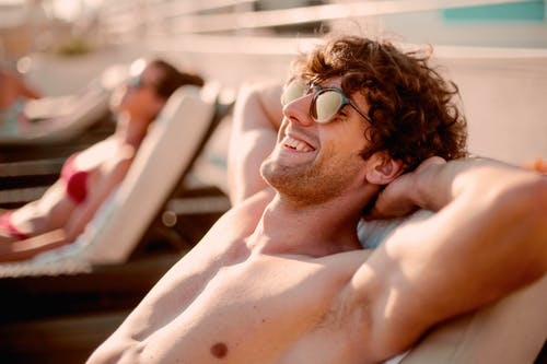 Topless Man Wearing Black Sunglasses