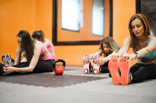 Photo of Women Doing Stretching