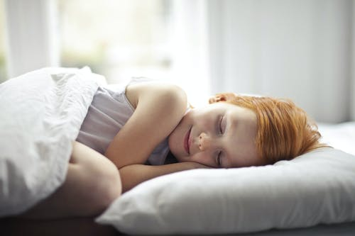 Girl Lying on Bed