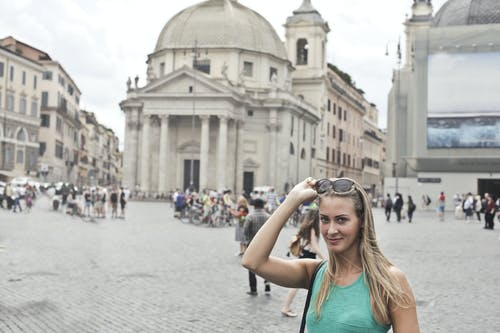 Happy traveler visiting old square in city