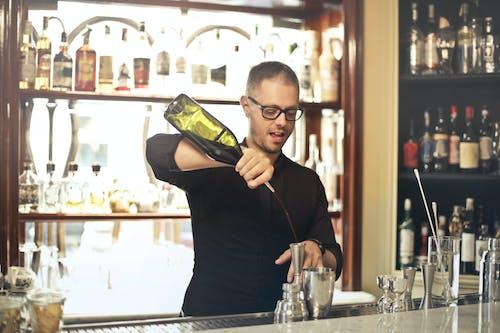 Barman preparing cocktail at counter