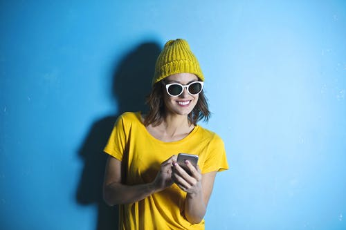 Woman in Yellow Crew Neck T-shirt While Smiling