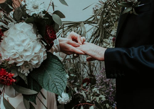 Bride and groom exchanging rings during wedding