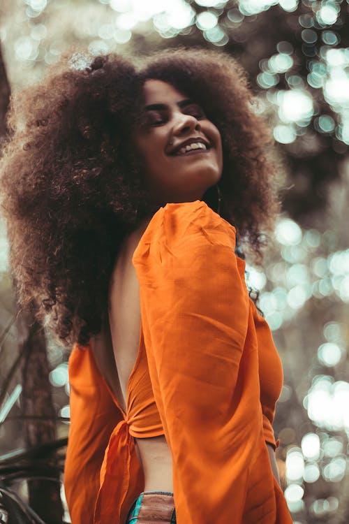 Woman Wearing Orange Top