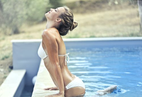 Woman in White Bikini Near Poolside