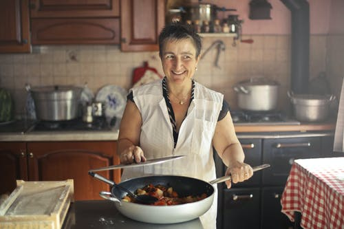 Woman Wearing Apron While Smiling