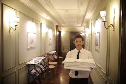 Man Holding White Linen Ad White Towel