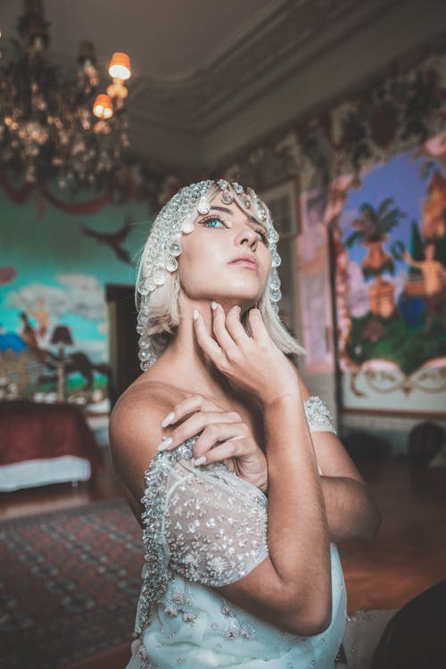 Gentle female in lace dress and head jewelry