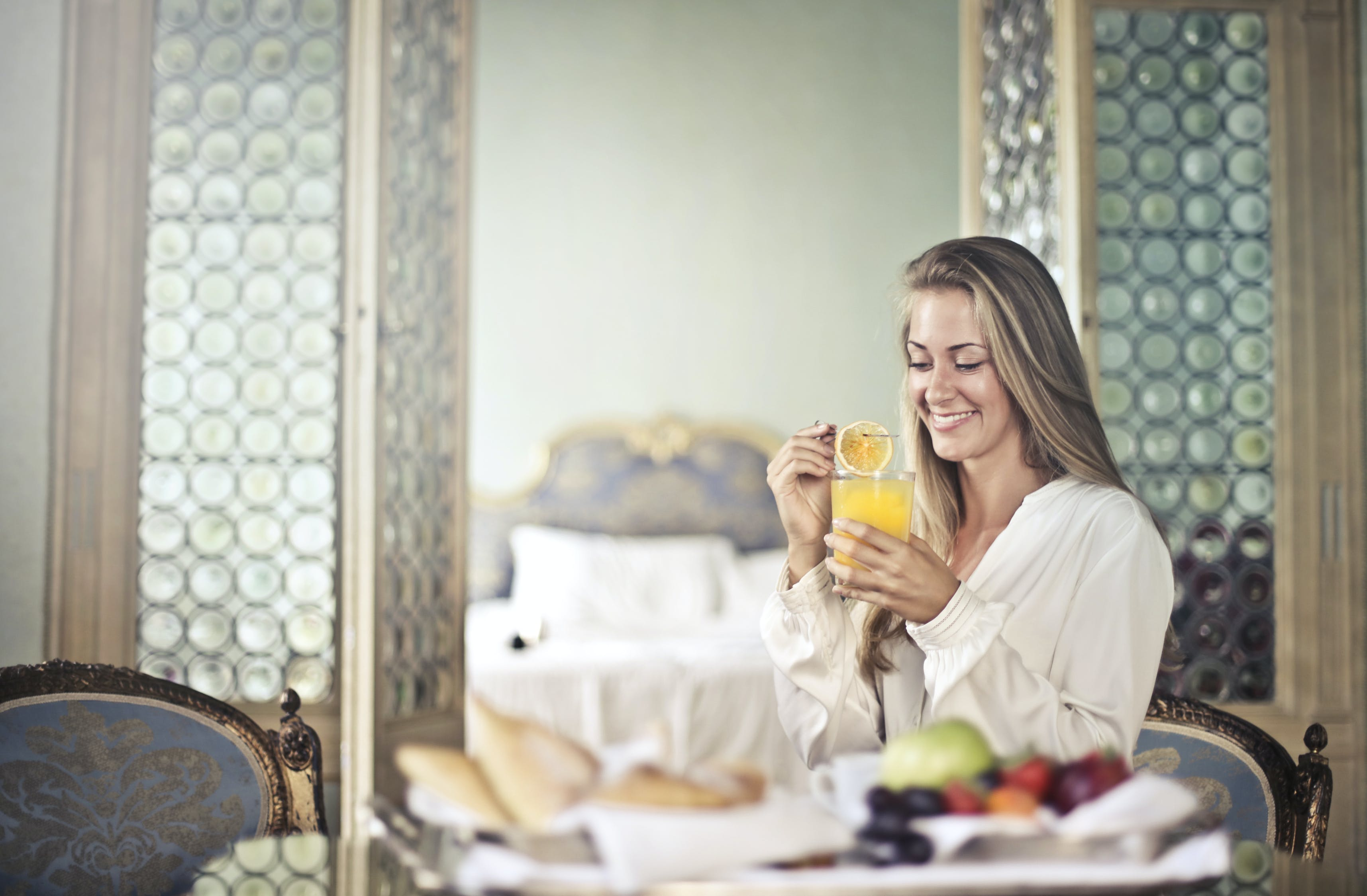 Cheerful woman enjoying breakfast in morning