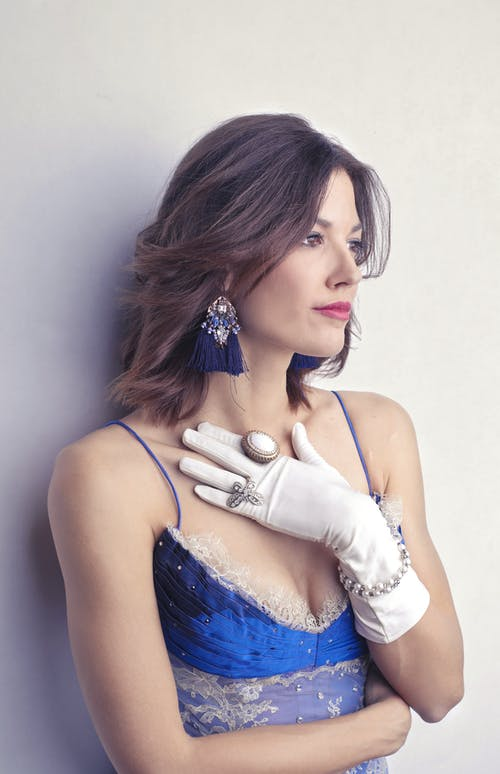 Female model in elegant clothes and glove with accessories