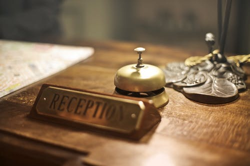 Reception desk with antique hotel bell