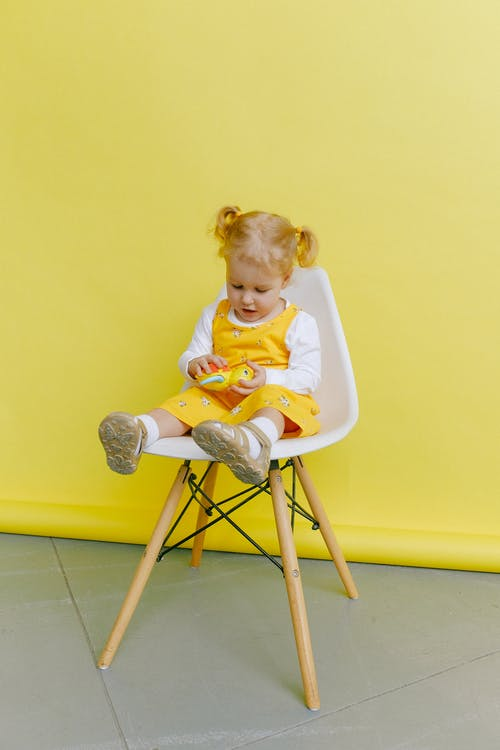 Baby Girl Sitting on Chair