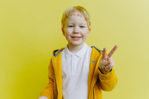 Boy in Yellow Zip Up Jacket