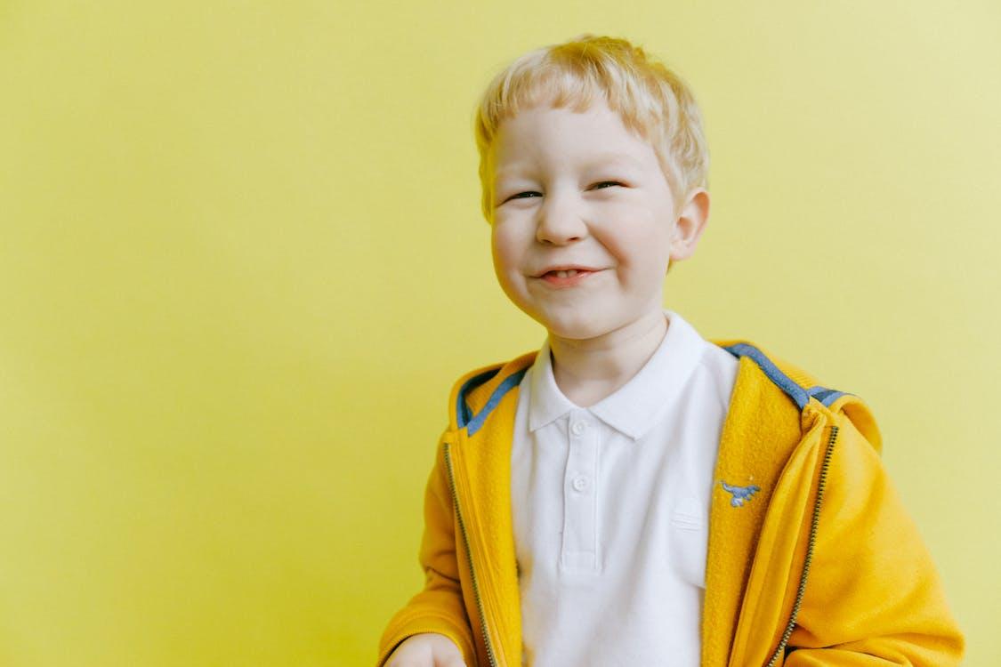 Boy in Yellow Zip Up Jacket