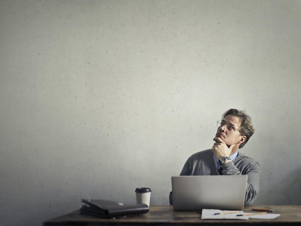 Photo of a Man Using Laptop