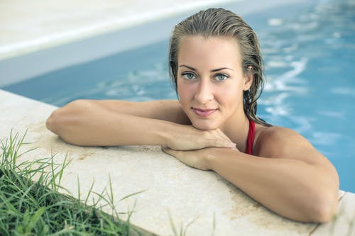 Close-up Photography of Woman in Swimming Pool