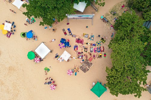Resort beach with tourists from drone