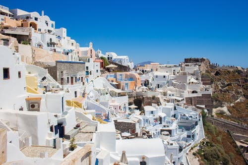 White Concrete Houses Under Blue Sky