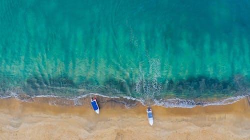 Moored boats on tropical ocean shore
