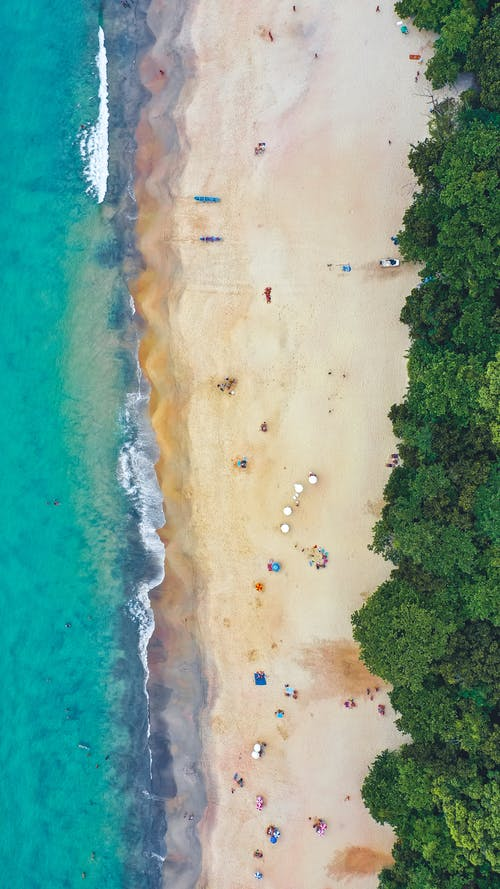 Ocean coast with tourists on beach
