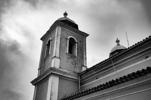 Old church tower under gloomy sky