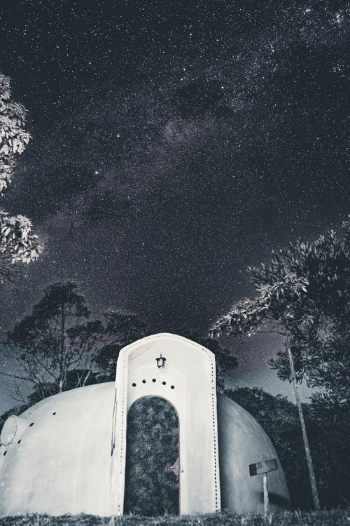 White Concrete Building Under Starry Night
