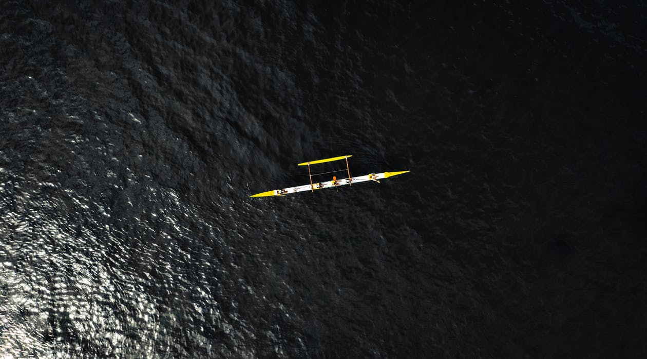 Aerial Photography of Small Vessel On Sea