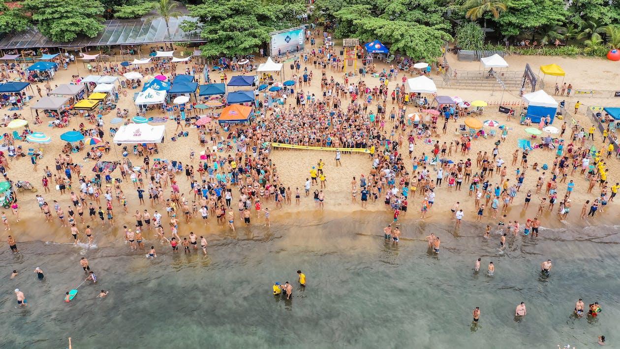 People Enjoying Their Beach Vacation