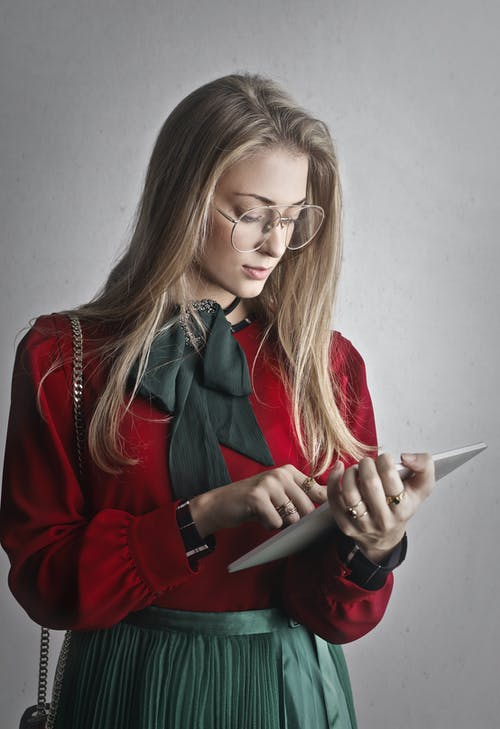 Woman in Red long Sleeves Holding A Tablet