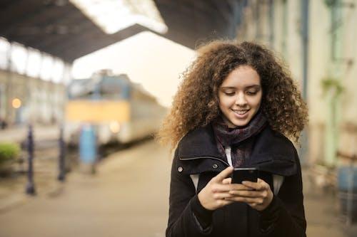 Girl in Black Coat Standing on Train Station