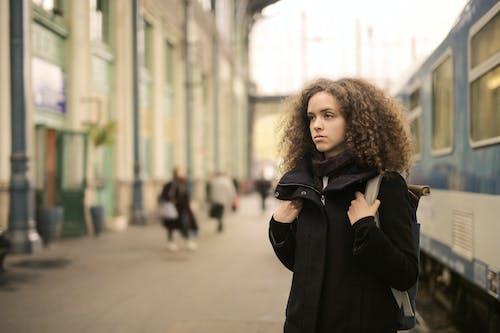 Woman in Black Coat Standing Standing Beside Subway
