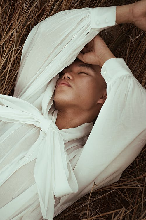 Man Lying on Brown Dried Grass