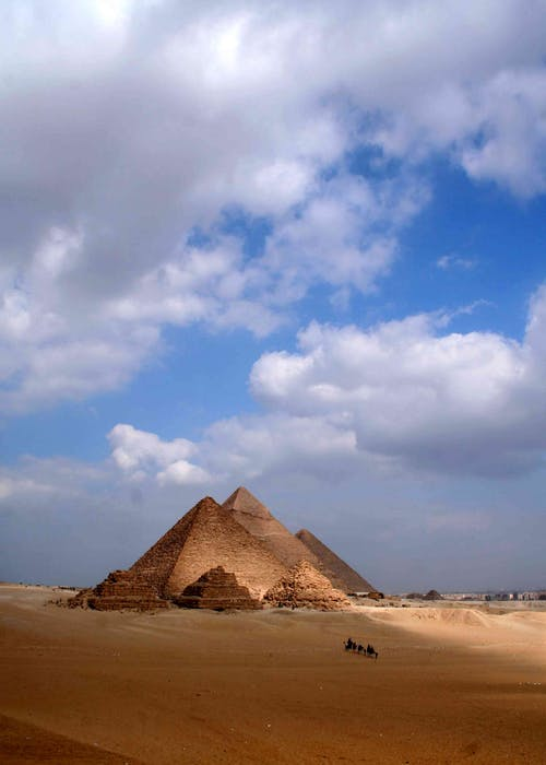 Ancient stone pyramids in dry sandy desert