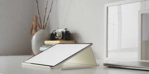 White Tablet and Stylus Pen On White Table