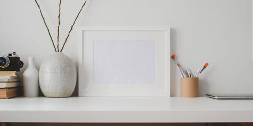 White Wooden Frame on White Flat Board