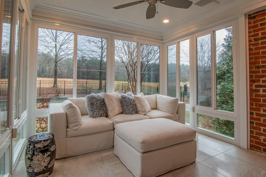 White Sofa Near Glass Window
