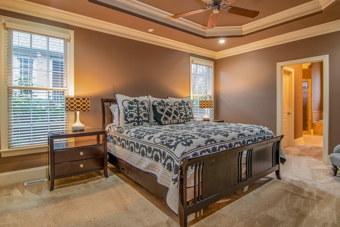 Brown Wooden Bed Inside Bedroom