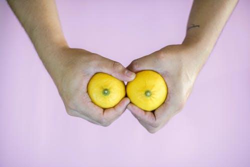 Person Holding Lemons