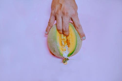Fingers On Melon