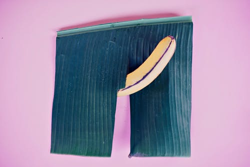 Yellow Banana on Purple Background