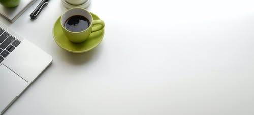 Green Ceramic Mug Filled With Black Coffee