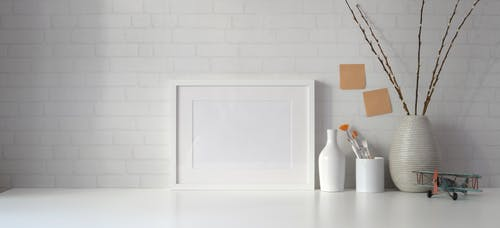 White Wooden Frame on White Wooden Table