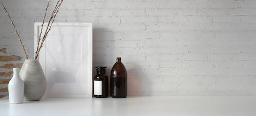 Gratis stockfoto met binnen, binnenshuis, bloemenvaas, bureau