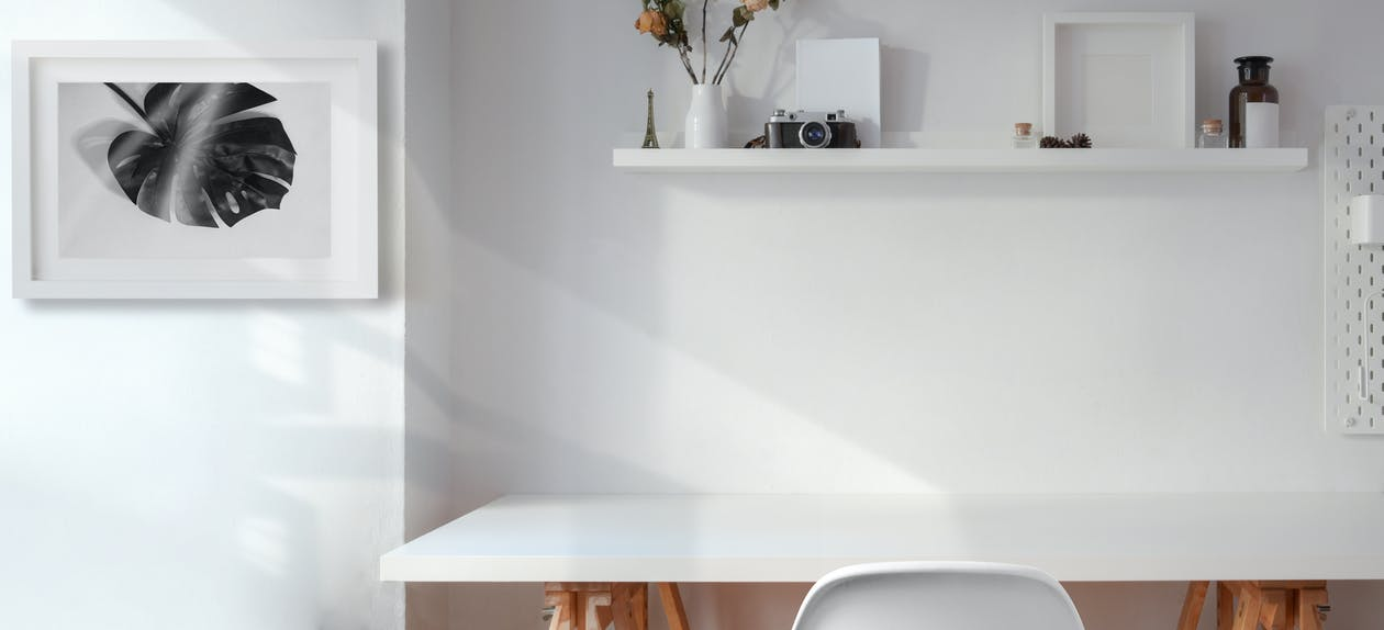 White Wooden Table Near White Wall