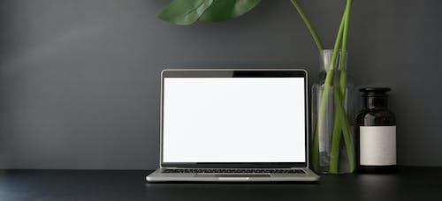 Computer Laptop Near Gray Wall