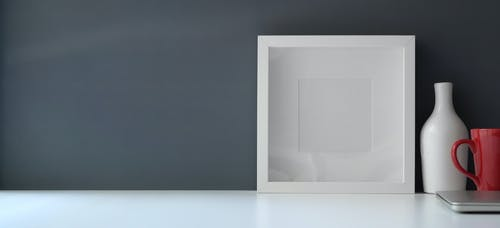 White Wooden Frame on White Flat Board