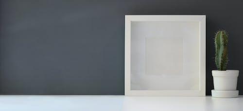 Darmowe zdjęcie z galerii z aparat, bezprzewodowy, biały, biurko